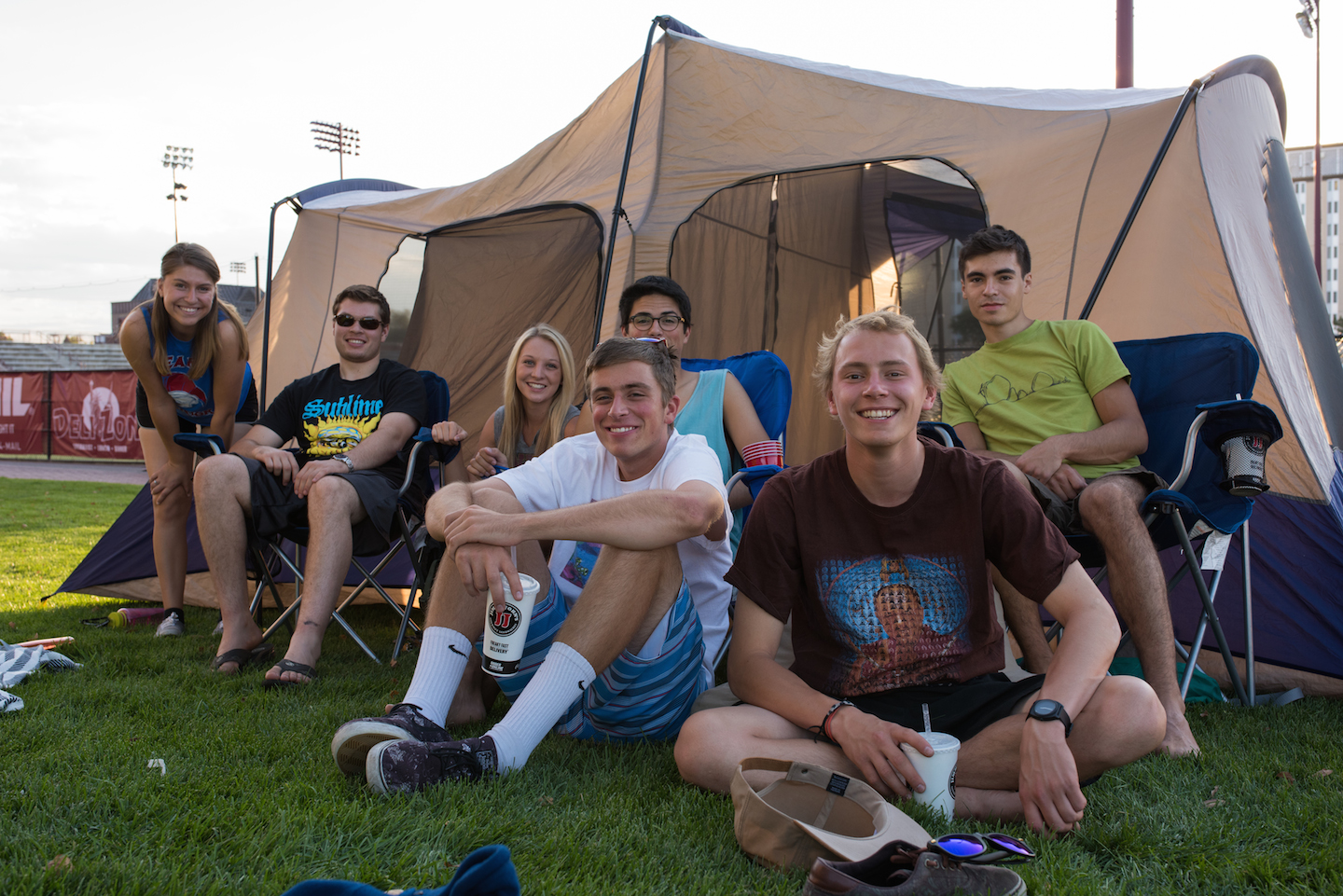 Photo courtesy of Jacob Pearlstein | Seven Denver students gather around their tent on Sept. 26 during the annual hockey ticket campout outside of DU's Ritchie Center.