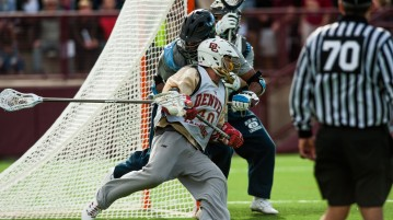 The No. 2 DU defeated Johns Hopkins 14 - 10 in the first exhibition match of the season. Photo by Gusto Kubiak