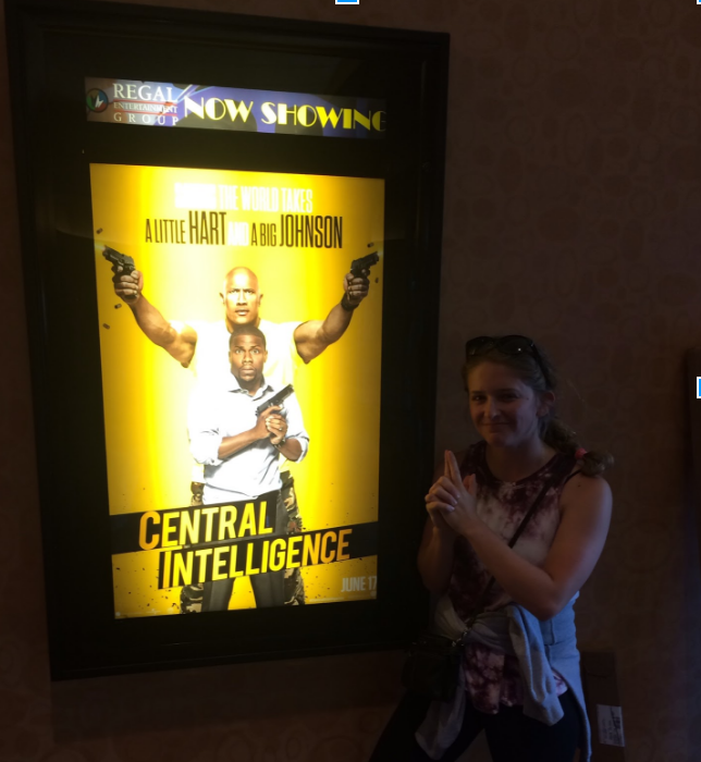 "Madison posing by the poster for ""Central Intelligence"". Madison Heller 