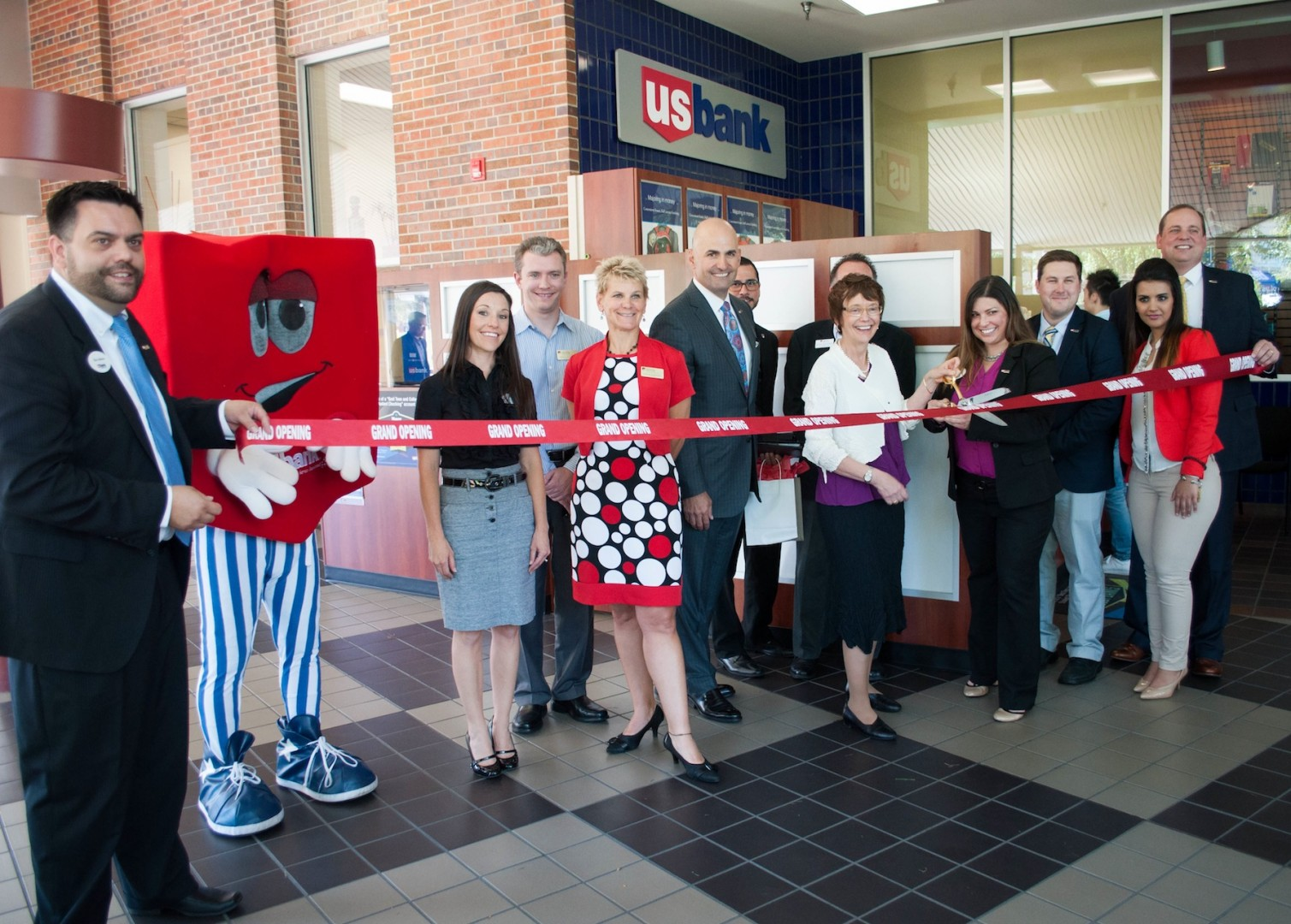 Breanna Demont | Clarion  Chancellor Rebecca Chopp, fifth from right, helped open the U.S. Bank on campus on Sept. 16.